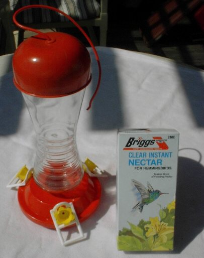 Glass humming bird feeder
