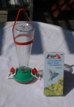 Plastic humming bird feeder